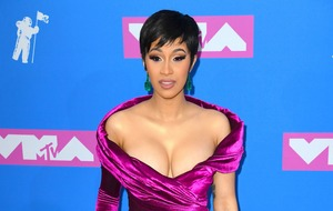 Cardi B shows off toned stomach as she asks fans for advice over 'black line'