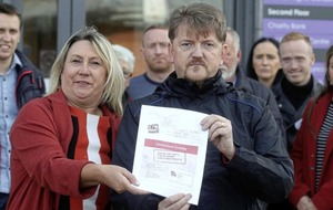 Top civil servant confronted by welfare reform campaigners in Belfast street