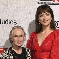 Dakota Johnson poses on red carpet alongside grandmother Tippi Hedren
