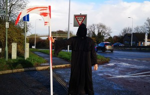 This is why the grim reaper is lurking at a road junction in Surrey