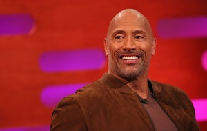 Dwayne Johnson lets daughter paint his face before work