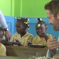 Gerard Butler shares meal with children in Haiti on Mary's Meals visit