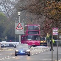Man dies after crash involving bus