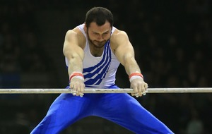 British gymnast breaks world record with 19-foot leap between bars