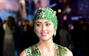 Amber Heard wows at Aquaman premiere in emerald cap and gown