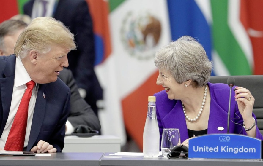 British prime minister Theresa May speaks with US president Donald Trump during the G20 summit in Buenos Aires