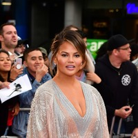 Chrissy Teigen reveals son Miles needs a helmet for 'slightly misshapen head'