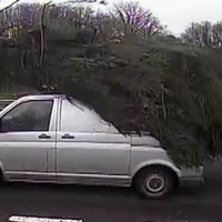 Van drives down dual carriageway with huge Christmas tree on its roof