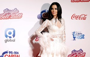 Cheryl dazzles in feathered dress at Jingle Bell Ball