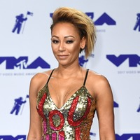 Mel B cancels book signing after breaking ribs and injuring hand