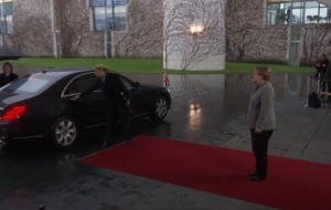 Theresa May gets locked in her car on the way to meet Angela Merkel in Germany