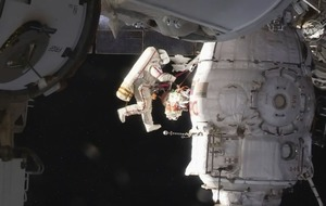 Space station crew on spacewalk to inspect mysterious hole