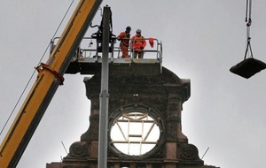 Iconic clock removed from Bank Buildings in Belfast - almost four months after Primark fire