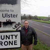 Bi-lingual sign daubed with loyalist graffiti