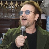 U2's Bono urges crowd to dig deep for homeless as he busks in Dublin