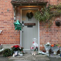 Fans leave tributes outside home of George Michael on anniversary of his death