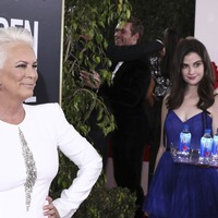 'Fiji Water Girl' steals the show on the Golden Globes red carpet