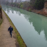 Manchester canal turns bright blue