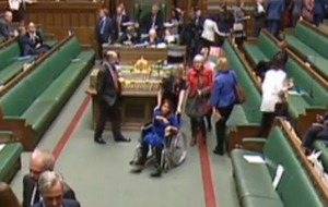 MP who delayed Caesarean op to vote on Brexit deal enters Commons in wheelchair