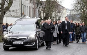 Priest condemns violence at funeral of father-of-two shot in Warrenpoint