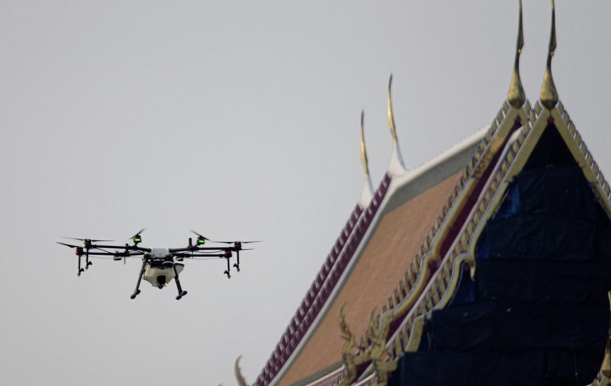 f5a302baecc Drone pilots fly a water-spraying drone over the Suthat Temple in Bangkok,  Thailand Picture by Sakchai Lalit/AP