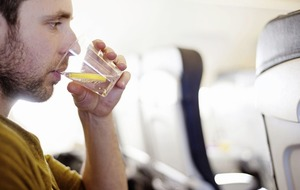 Like a drink (or three) on a flight? Here's how alcohol affects your body in the air