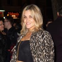 Ashley Roberts styles on-trend leopard print ensemble at Rip It Up press night