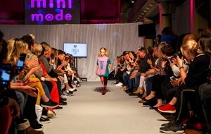 8-year-old double amputee cartwheels down the catwalk at London Fashion Week