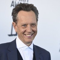 Richard E Grant pays tribute to Aids victims as he wins Indie Spirit Award