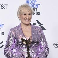 Glenn Close walks Independent Spirit Awards blue carpet with her dog