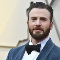 Chris Evans hailed a 'gentleman' for helping Regina King up to Oscars stage