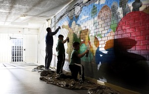 Children of prisoners create colourful mural in Maghaberry as part of unique art project