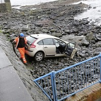 Woman aged in thirties arrested after car plunges over sea wall in Co Derry