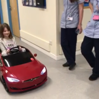 Eight-year-old hospital patient uses miniature Tesla to drive to surgery