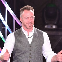 James Jordan swigs from wine bottle at Dancing On Ice after-party