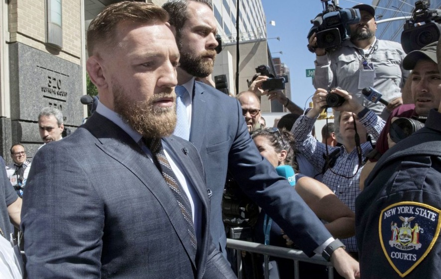 McGregor is arrested for 'theft' of fan's cellphone