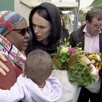 Mourners pay tribute at makeshift memorial to the 50 people killed by a gunman