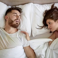 Sleeping next to a loud snorer? Here's how to finally get some peaceful shut-eye