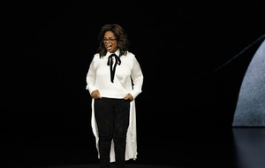 Oprah Winfrey gets standing ovation as she announces new shows at Apple event
