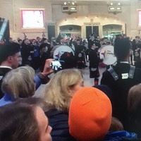 Young Scots pipers in flash mob performance at Grand Central Station