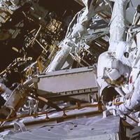 Spacewalking astronauts complete space station battery and cable work