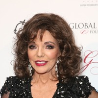 Joan Collins flees London flat as sun on mirror sparks bathroom fire