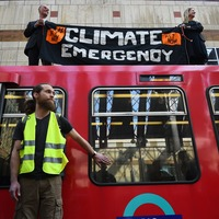 Climate change protesters climb on roof of London train