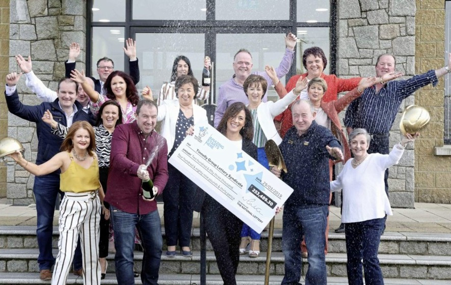 Co Down syndicate celebrate winning lottery ticket - The