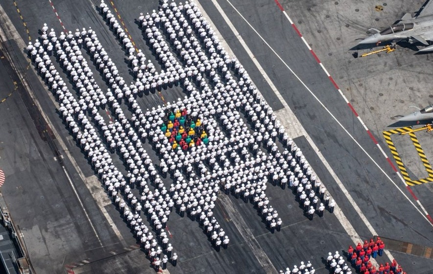 French sailors pay tribute to Notre Dame by lining up in the cathedral's shape