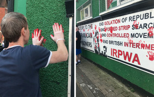 Friends of Lyra McKee place red handprints on Saoradh's Derry HQ