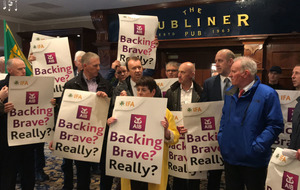 Farmers storm Allied Irish Banks meeting in protest of sale of loans to vulture funds
