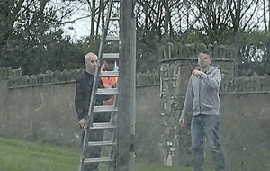 UUP election candidate 'willing to meet Loughinisland families' after suspect pictured helping put up election posters