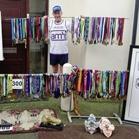 A 99 at the finish line keeps 62-year-old Oggie on the road to 500 marathons