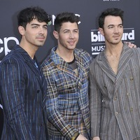 Jonas Brothers cheered on by their famous partners during Billboard performance